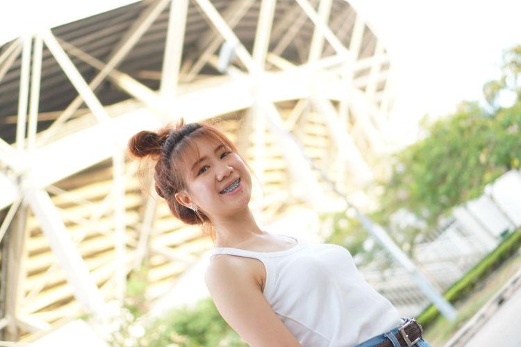 EyeEm Selects Young Women Smiling Portrait Cheerful Happiness City Headshot Women Enjoyment Sky