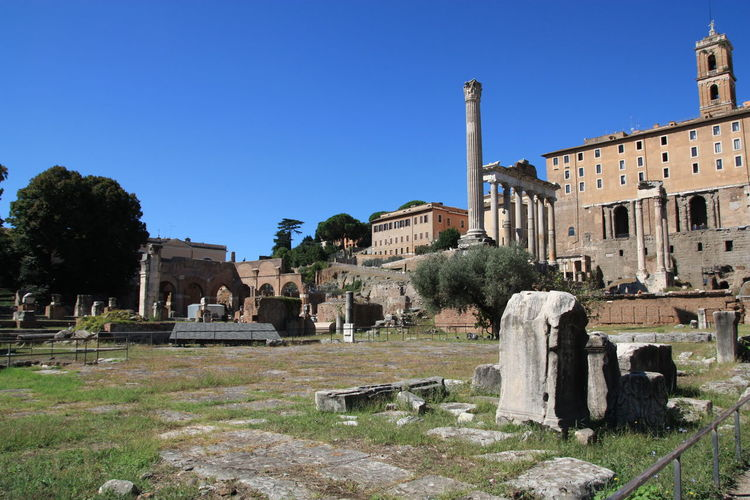 High angle view of old ruins at roman forum against clear blue sky
