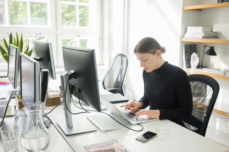 Midsection Of A Woman Working N Desk