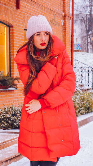 Beautiful happy smiling woman on the street in warm red winter coat on Christmas time on snowing. Winter Cold Temperature Warm Clothing Snowing Smiling Christmas Wintertime Woman Power women around the world EyeEm Best Shots EyeEm Colorful! Fashion Stories Red Lipstick Snow Clothing One Person Women Hat Portrait Standing Young Adult Day Looking At Camera Coat Red Long Hair Real People Girls Scarf Winter Coat Hair Beautiful Woman Outdoors