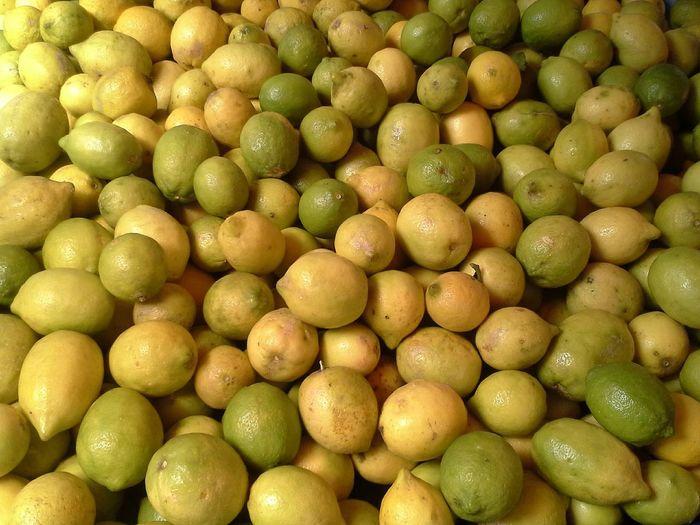 Full frame shot of fresh lemons in market