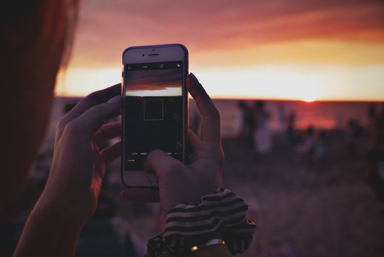 Sunset Time. Popckorn Technology Wireless Technology Photography Themes Mobile Phone Smart Phone Holding Communication Human Hand Photographing Real People Using Phone Telephone Focus On Foreground Sunset Activity The Traveler - 2018 EyeEm Awards