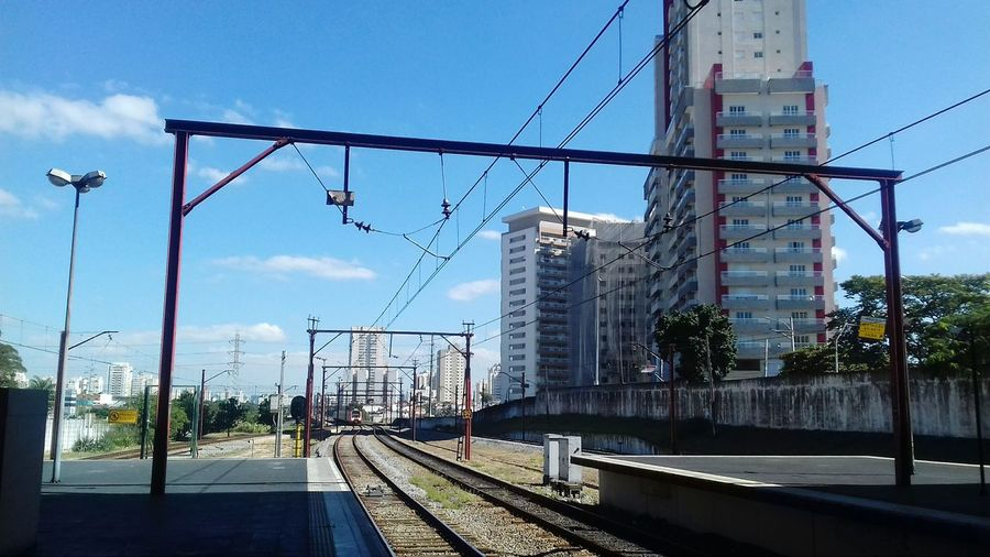 Nos trilhos de Sao Paulo... City Electricity Pylon Cable Railroad Track Public Transportation Rail Transportation Electricity  Train - Vehicle Business Finance And Industry Power Line  Railway Signal Overhead Cable Car Crossing Sign Steel Cable Railroad Crossing Railway Bridge Bridge - Man Made Structure Stoplight