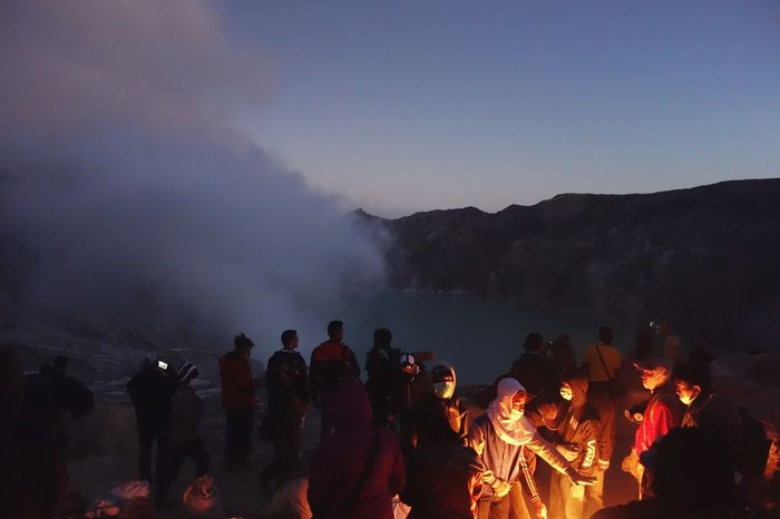 Local people try to warm up on the top of Vulcan Kawah Ijen on the island ofJava ( Indonesia ) Insta Instadaily Instamood Instalike Instapic Instacool Instaphoto INDONESIA Indonesia_photography Follow4follow Folow Me Fire Lifestyles Nature Burning Outdoors Landscape Real People Mountain Large Group Of People Flame Smoke - Physical Structure Illuminated ASIA Asian