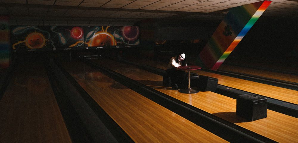 Sitting on the Bowling Alley Adult Adults Only Day Illuminated Indoors  Leisure Activity Musical Instrument One Man Only One Person Only Men People Performance Real People Young Adult