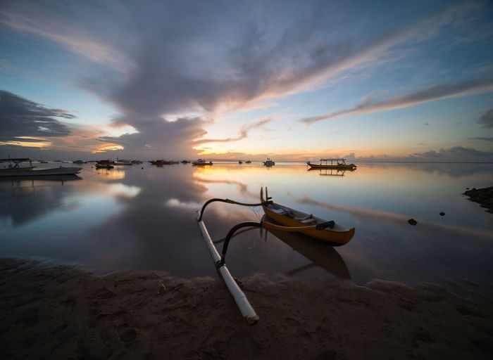 Sky Water Cloud - Sky Tranquility Scenics - Nature Sunset Tranquil Scene Sea Beauty In Nature Reflection Beach Nature Land No People Nautical Vessel Transportation Idyllic Mode Of Transportation Non-urban Scene