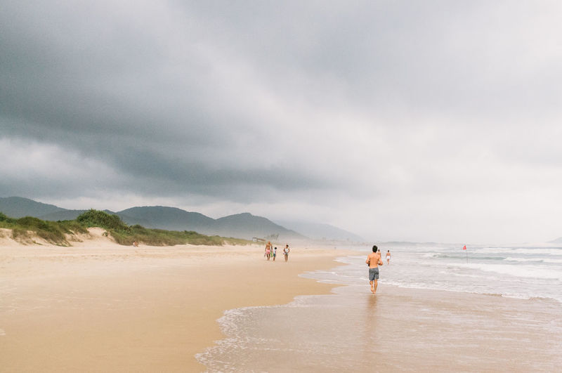 Beach Beauty In Nature Brazil Cloud Cloud - Sky Day Florianópolis Full Length Horizon Over Water Leisure Activity Lifestyles Men Nature Outdoors Real People Running Sand Scenics Sea Shore Sky Tranquility Vacations Water Wave