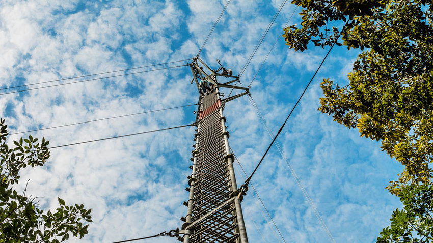 3g 4g Base Station Mobile Phone Cable Cellular Cloud - Sky Communication Day Electricity  Engineering Equipment Fuel And Power Generation Industry Low Angle View Manual Worker Outdoors People Sky Technology Telecommunications Equipment Telephone Line Tower Tree Working