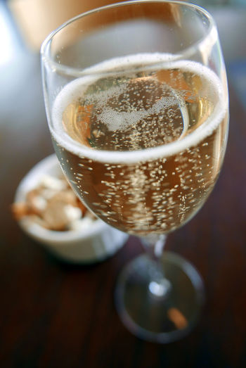 Close-Up Of Champagne Served In Flute On Table At Restaurant