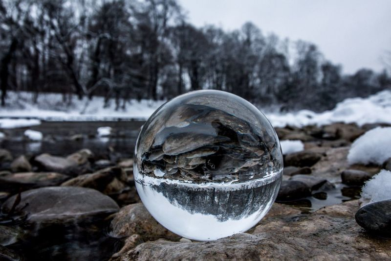 Glass ball Cold Temperature Snow Focus On Foreground Nature No People Outdoors Tourism Landscape