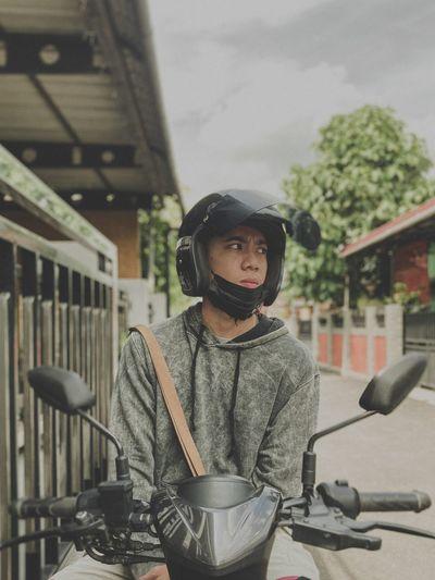Man on motorcycle looking away