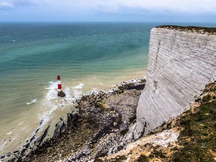 Beachy Head Lighthouse Water Sea Sky Horizon Over Water Horizon Beach Land Scenics - Nature Beauty In Nature Nature Day One Person Tranquil Scene Holiday Vacations Tranquility Leisure Activity Non-urban Scene Outdoors Looking At View Lighthouse Uk Beachyhead