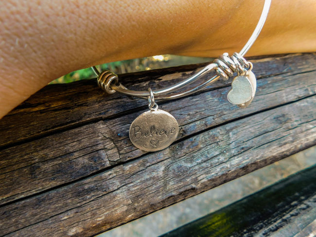 Believe EyeEmNewHere Faith God Motivation Believe Bracelet Close-up Day Hanging Human Hand Jewellery Locket Locket_of_love Outdoors Wood - Material You Can