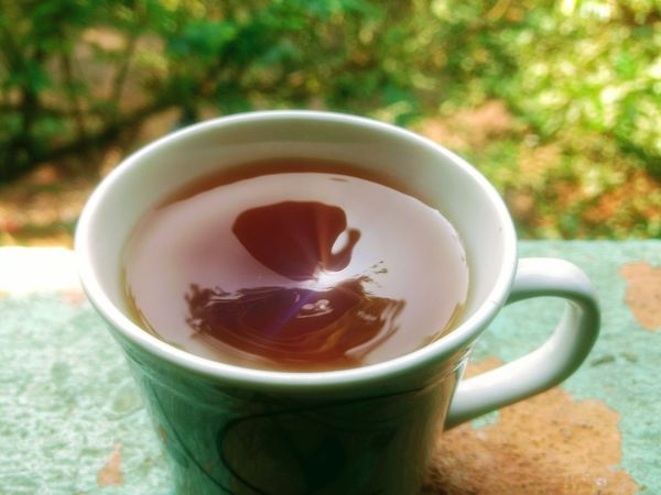 Candid Drink Cup Tea - Hot Drink High Angle View Close-up No People Refreshment Food And Drink Heat - Temperature Day Outdoors Freshness