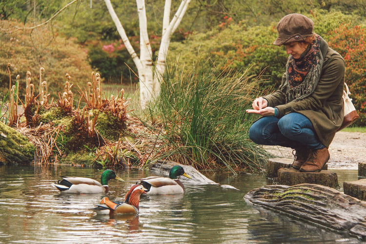 Bonding Boys Casual Clothing Childhood Ducks Feeding  Full Length Girls Isabella Plantation, Richmond Park Lake Leisure Activity Person Pond Pond Life Rear View Togetherness Tree Water Waterfront Original Experiences People And Places Exploring Style EyeEm LOST IN London Postcode Postcards 50 Ways Of Seeing: Gratitude