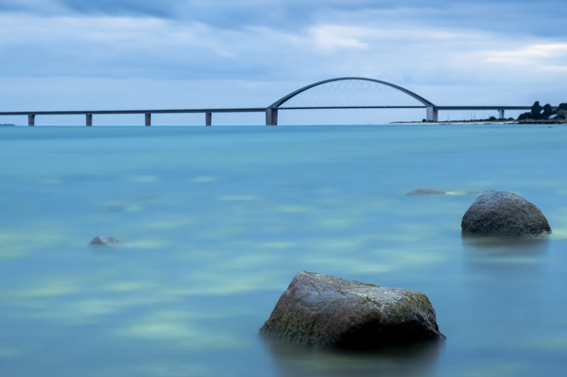 Bridge over Fehmarnsund Baltic Sea Fehmarnsundbrücke Schleswig-Holstein Traffic Architecture Beauty In Nature Bridge Bridge - Man Made Structure Cloud - Sky Connection Fehmarn Long Exposure Nature No People Outdoors Rock Rock - Object Scenics - Nature Sea Solid Tranquil Scene Tranquility Travel Destinations Water Waterfront