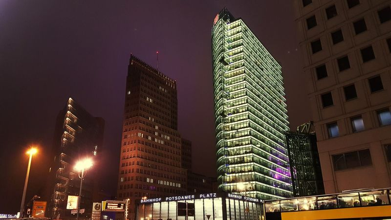Skyscraper City Night Illuminated Architecture Sky Modern Low Angle View Urban Skyline No People Cityscape Outdoors Downtown District Berlin Potzdamer Platz Built Structure