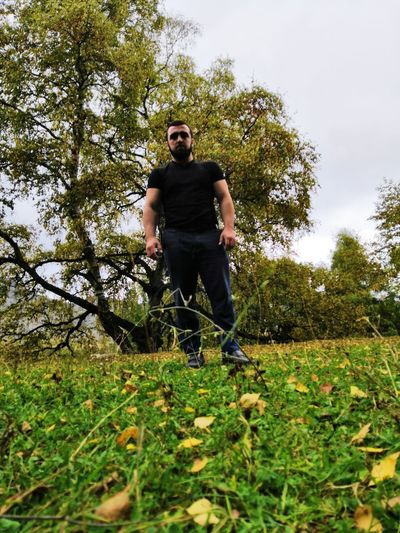 Full length of young man against trees