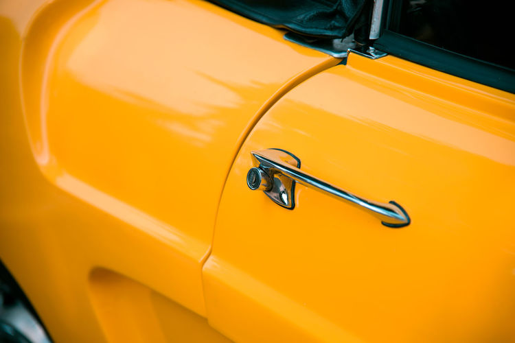 Close up yellow retro classic car Classic Retro Wheel Car Car Door Close-up Day Door Handle Handle High Angle View Land Vehicle Mode Of Transportation Motor Vehicle No People Outdoors Retro Styled Sunlight Transportation Vintage Vintage Car Yellow