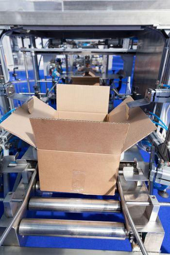 Cardboard package box on a packing machine. Automatic cardboard box erector machine Machine Packaging Industry Production Automated Box Business Cardboard Cardboard Box Carton Conveyor  Factory Industry Loading Manufacturing Manufacturing Equipment No People Package Packaging Packing Packing Machine Produce Production Line Production Process Shipping  Technology