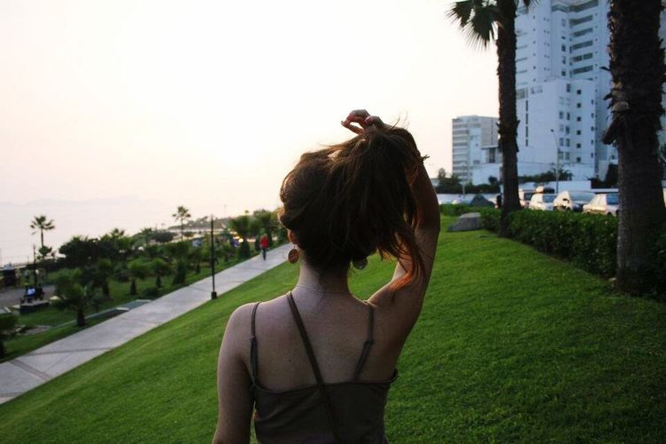 2012 Rear View Adults Only Outdoors People Grass Adult Built Structure One Woman Only Real People Day Sunset Architecture Only Women Building Exterior City Clear Sky Young Adult EyeEmNewHere
