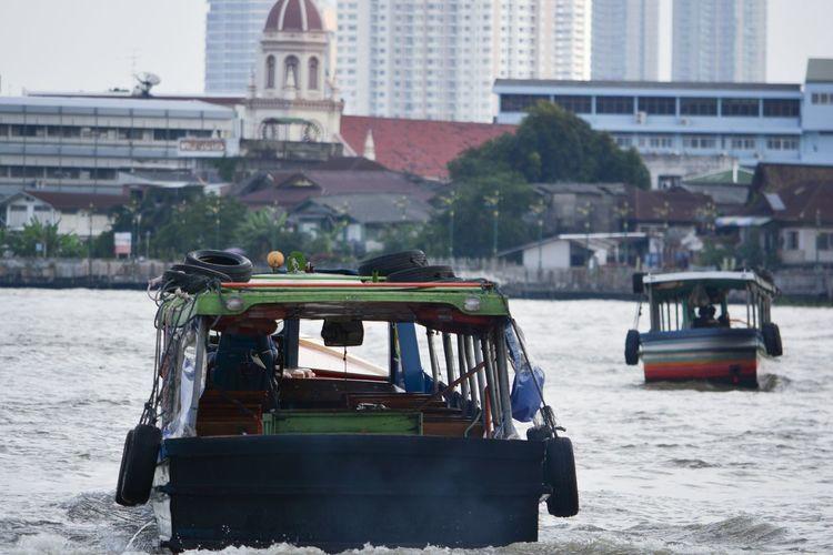Boat on river in city