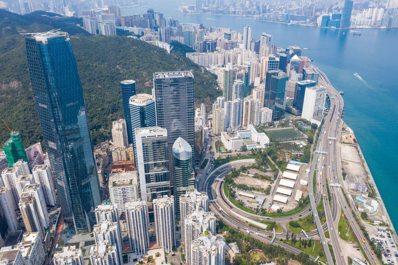 Aerial picture of Hong Kong city with many buildings City Building Exterior Architecture Built Structure Office Building Exterior Cityscape High Angle View Building Skyscraper Aerial View Water Travel Destinations City Life Transportation Day Modern Nature Office Landscape No People Outdoors Financial District