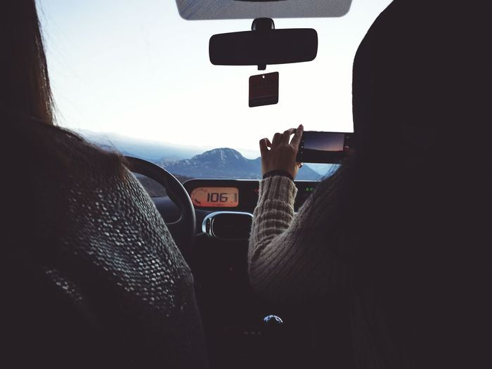 Woman driving in mountainous landscape