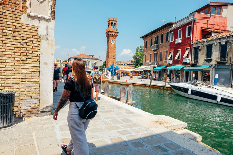 exploring a city Venice Venice, Italy Italy City Travel Travel Destinations Architecture Building Exterior Built Structure Water Real People Lifestyles One Person Casual Clothing Nature Day Canal Nautical Vessel Sunlight Standing Transportation Building Incidental People Outdoors Tourism
