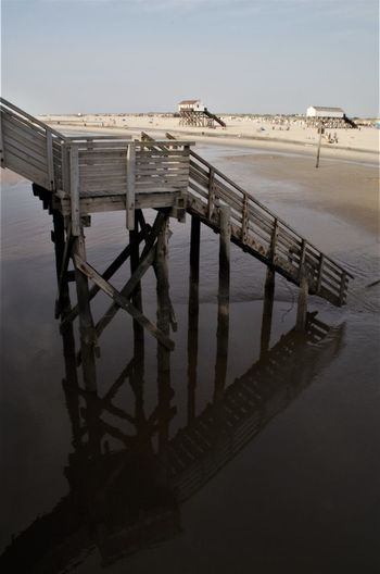 stairway to the beach St. Peter Ording Strandkorb Animal Animal Themes Architecture Building Exterior Built Structure Day High Angle View Nature No People Outdoors Pier Railing Reflection Sea Sky Tranquility Water Wood - Material Wooden Post