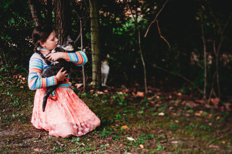Tree Child Childhood Forest Full Length Girls Emotion Togetherness Females Women Land Men Plant Bonding Love Nature People Side View Positive Emotion Innocence Outdoors Daughter Cats