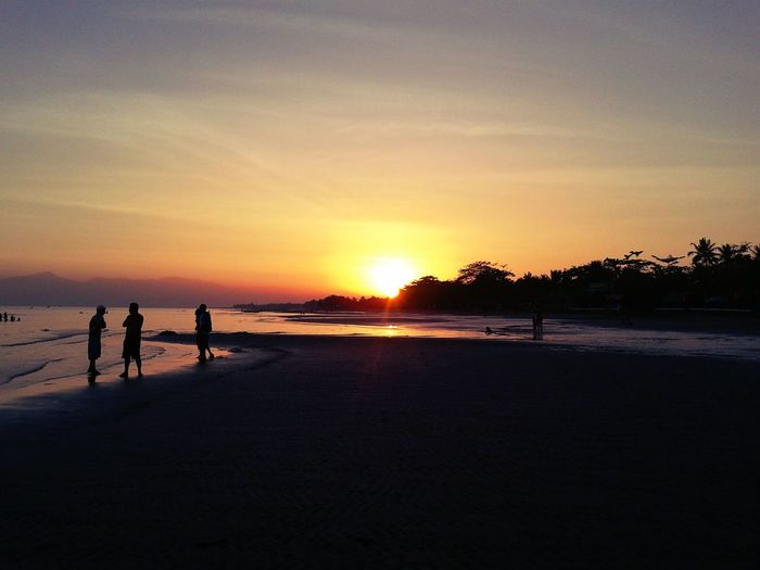 Beauty In Nature Dawn In Philippines Medium Group Of People Orange Color Scenics Shore Sunlight Tourism