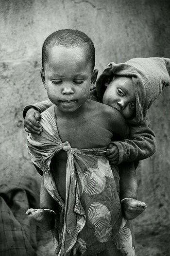Such sadness should never be seen in such a young one's eyes... Black And White Portrait Sad Faces  Wethepeople Poverty Africa People Photography