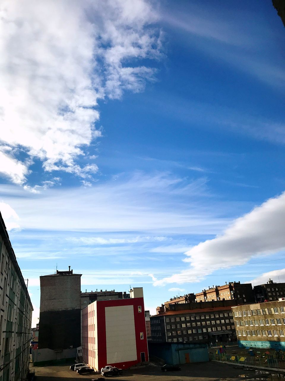 architecture, building exterior, built structure, cloud - sky, sky, building, residential district, city, nature, day, outdoors, no people, low angle view, house, blue, sunlight, city life, town, cityscape, window