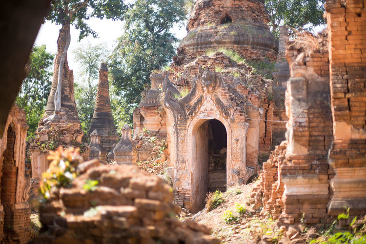 Shwe Inn Dein Pagoda, Inle Lake, Myanmar Buddha Ancient Ancient Civilization Architecture Belief Buddhism Built Structure Day History Inle Lake Low Angle View Nature No People Old Ruin Outdoors Place Of Worship Plant Religion Ruined Spirituality The Past Tourism Travel Travel Destinations Tree