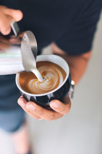 Barista Cappuccino Coffee Coffee - Drink Coffee Cup Cup Drink Finger Food Food And Drink Froth Art Frothy Drink Hand Holding Hot Drink Human Body Part Human Hand Indoors  Latte Lifestyles Mug One Person Real People Refreshment