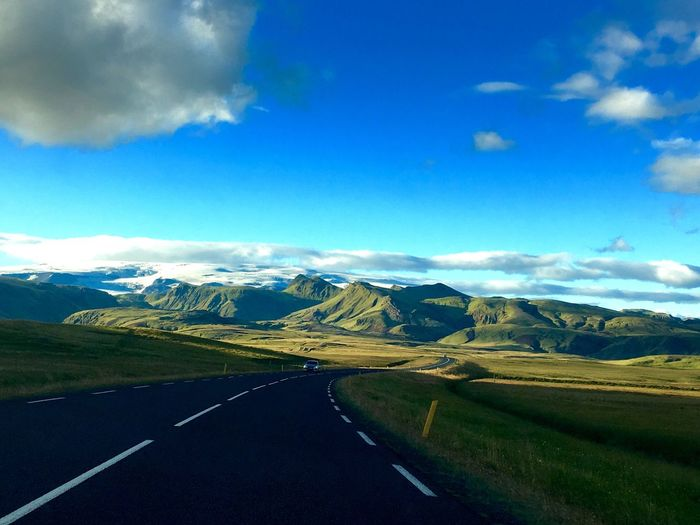 Sky Blue Scenics Mountain Landscape Nature Tranquility Tranquil Scene Road Non-urban Scene No People Beauty In Nature Cloud - Sky Idyllic Outdoors Day Grass Winding Road Way Travel Adventure Iceland Picoftheday Like4like My Year My View Traveling Home For The Holidays