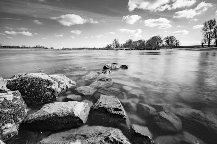 Rhein bei Düsseldorf Black & White Deutschland Düsseldorf EyeEm Best Shots EyeEm Nature Lover Meerbusch NRW Rhein Trees Beauty In Nature Black And White Blackandwhite Cloud - Sky Flowing Water Long Exposure Monochrome Nature No People Outdoors River Rock Rock - Object Sky Water Wide Angle