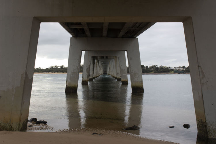 Architectural Column Architecture Beach Below Bridge Bridge - Man Made Structure Built Structure Connection Day Land Nature No People Outdoors Pier Sea Sky Underneath Water