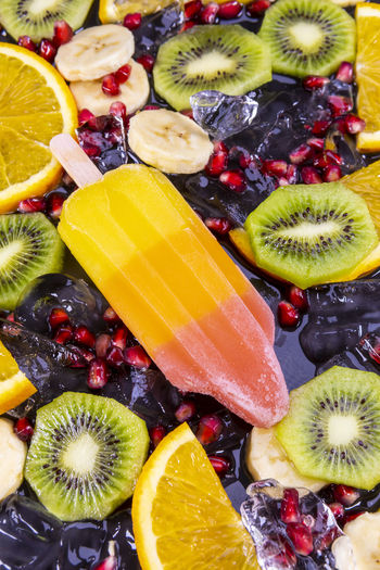 Directly Above Shot Of Popsicles And Fruits On Table