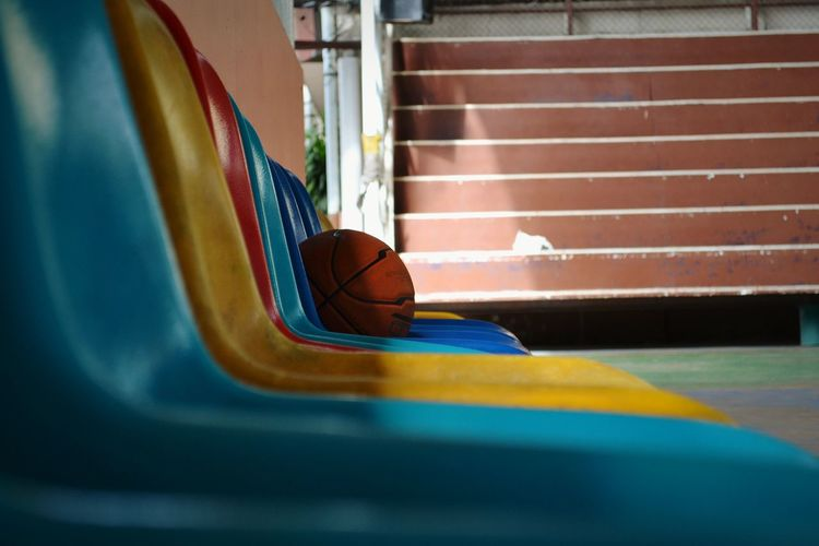 Basketball on chair at court