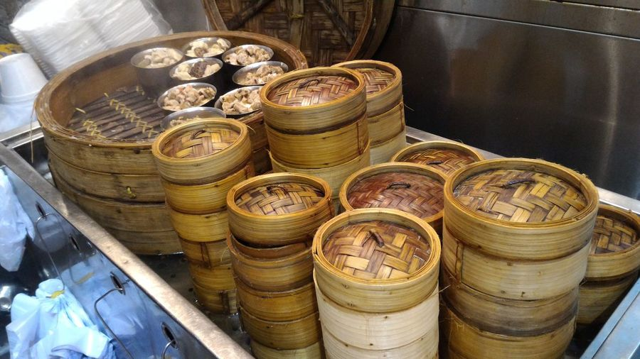 High angle view of bamboo steamers in container