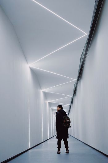 Lighting Equipment Light Architecture One Person Full Length Real People Built Structure Lifestyles Standing Leisure Activity Rear View Ceiling