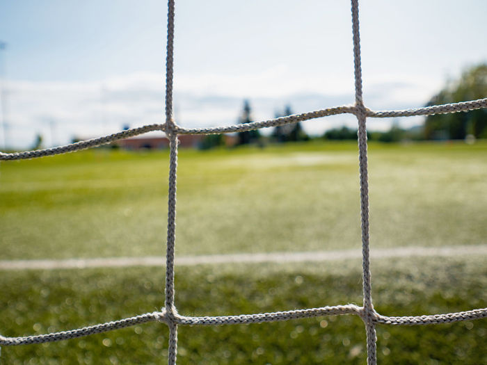 Low angle view of soccer field against sky