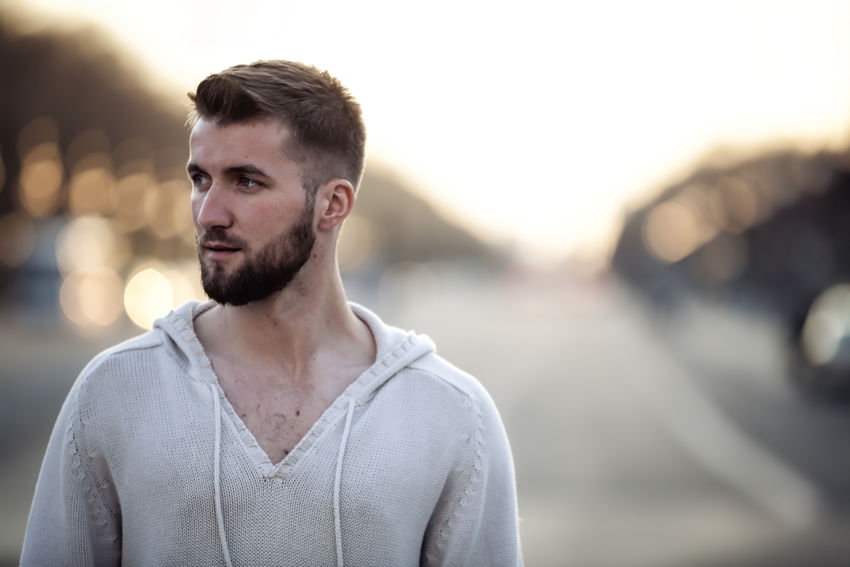 Portrait of a young thoughtful man in the Berlin Berlin Business City Copy Space Employee Isolated Man Background Beard Casual Clothing Close Up Close-up Confident  Day Leisure Activity Lifestyles Male Manager One Person Outdoors People Person Thoughtful Urban Young Adult