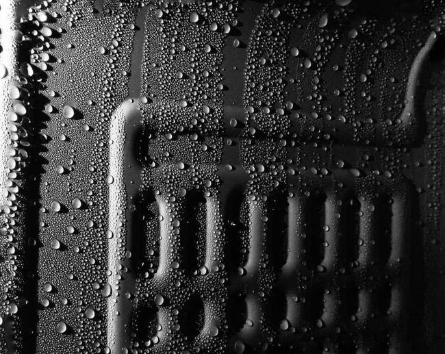 Full frame shot of raindrops on windshield