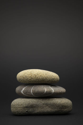 Close-up of stones against black background