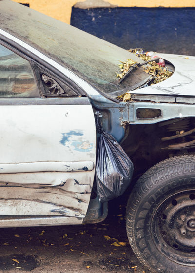 High angle view of damaged car on street