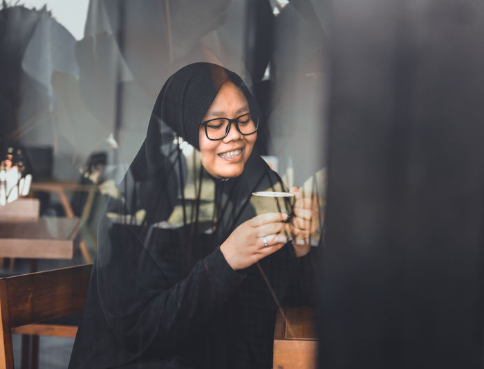 Coffee time Young Adult Smiling Drink Young Women Food And Drink Lifestyles Front View Refreshment Glass Glass - Material Women Leisure Activity One Person Indoors  Happiness Beautiful Woman Holding Real People Transparent Drinking
