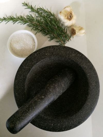 Directly Above Shot Of Mortar And Pestle By Ingredients In Kitchen